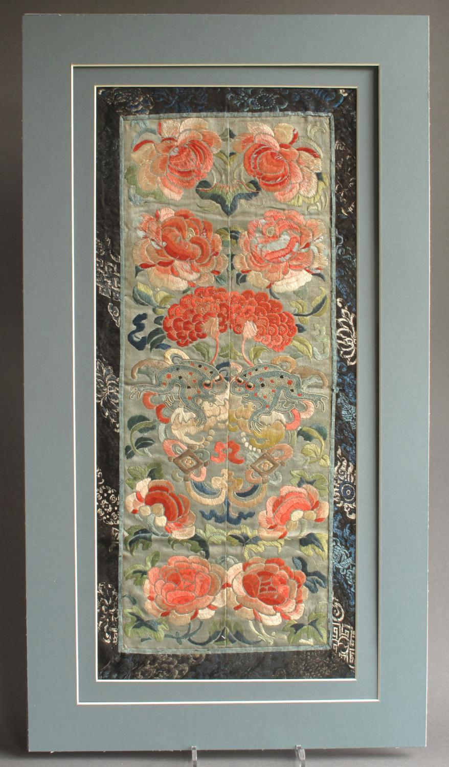 A pair of C19th Chinese silk sleeve bands