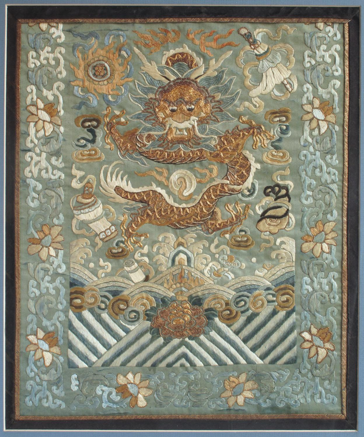A C19th Chinese silk embroidered dragon panel