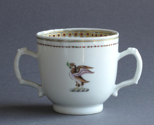 A Chinese armorial twin handled cup Qianlong