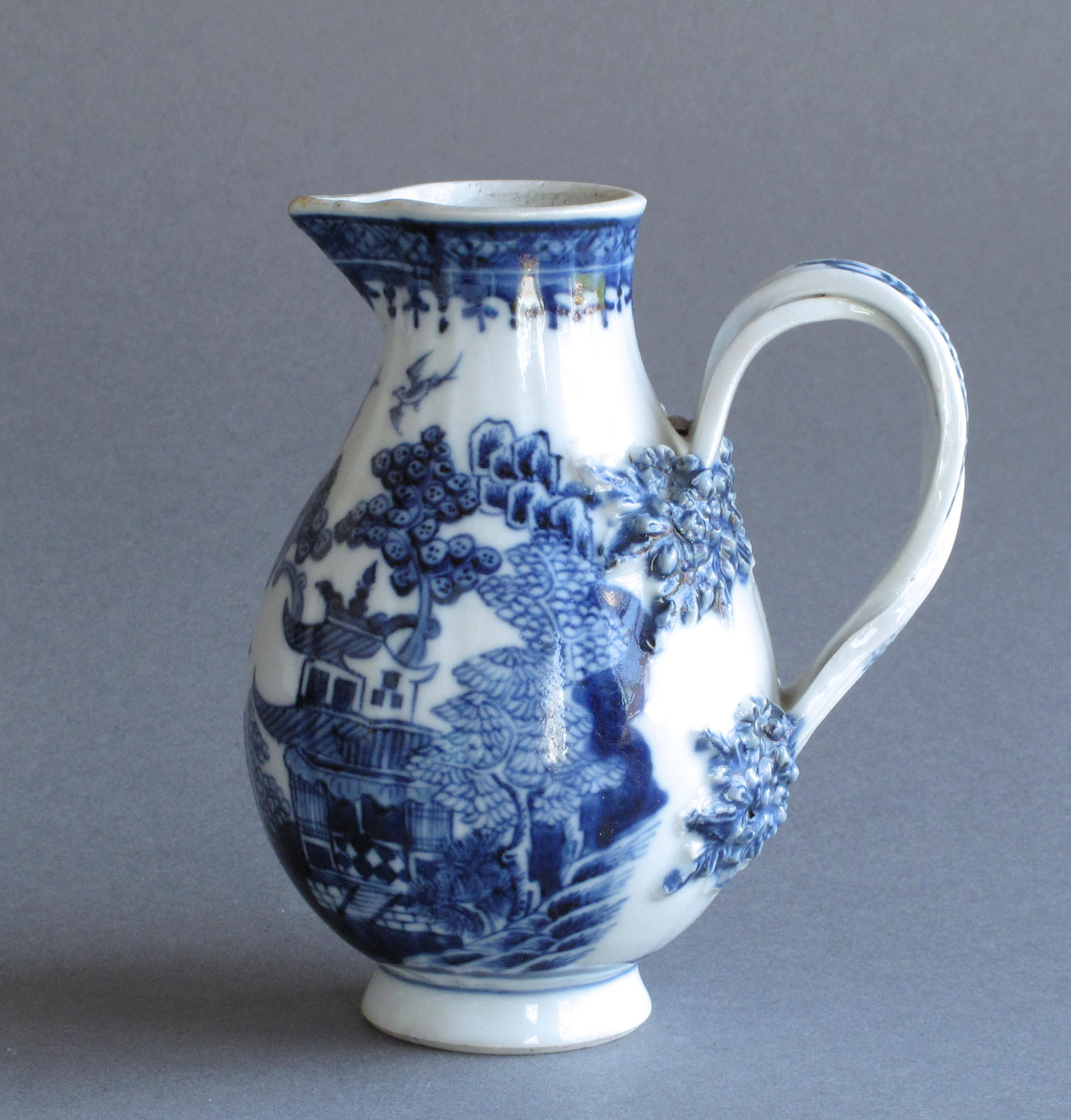 A Chinese export cream jug with double strap handle, Qianlong