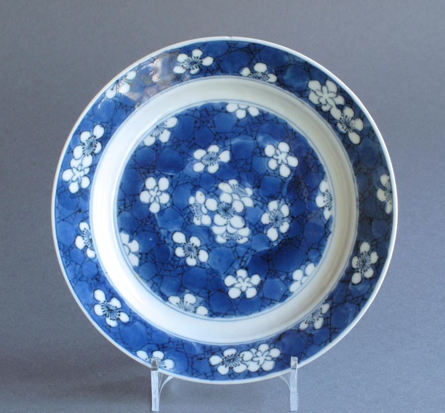 A Chinese 'prunus and cracked ice' plate, Kangxi
