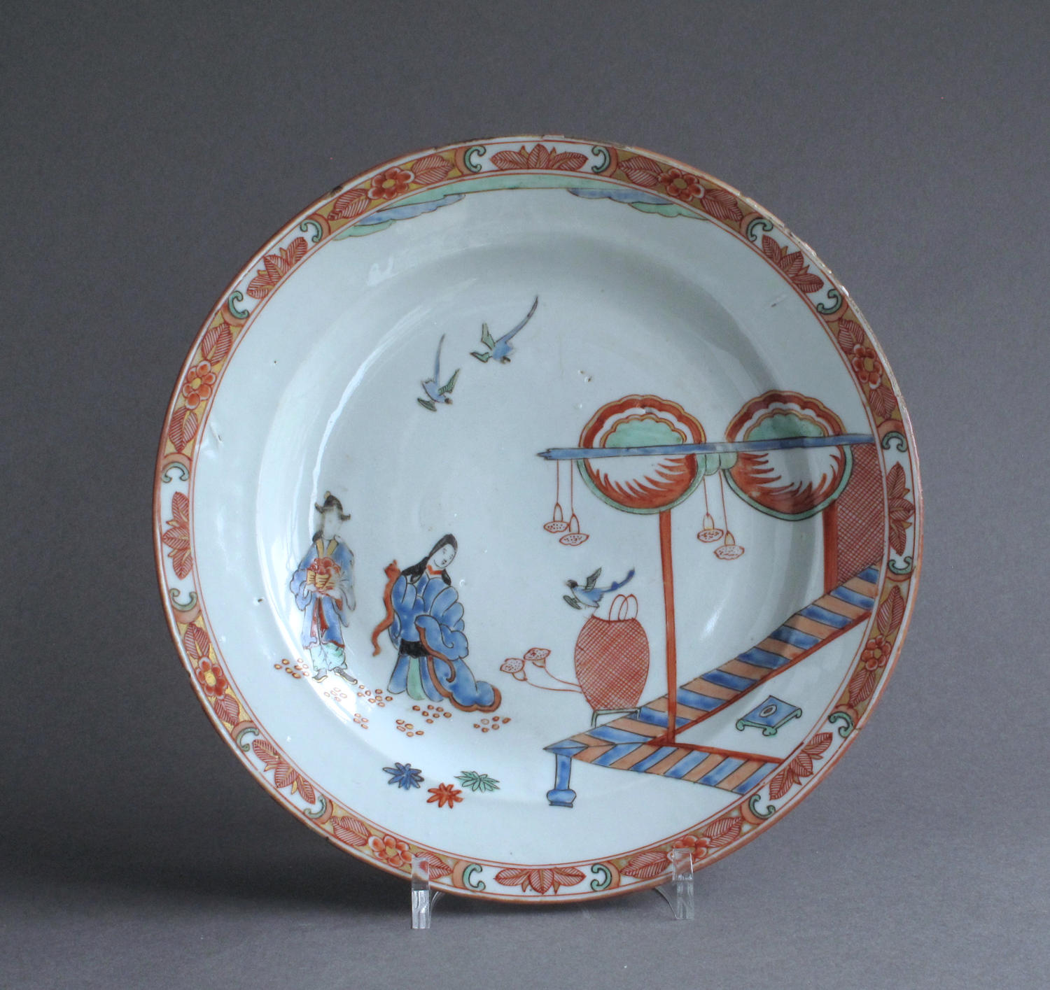 A Dutch-decorated Chinese plate with Japanese scene c1720