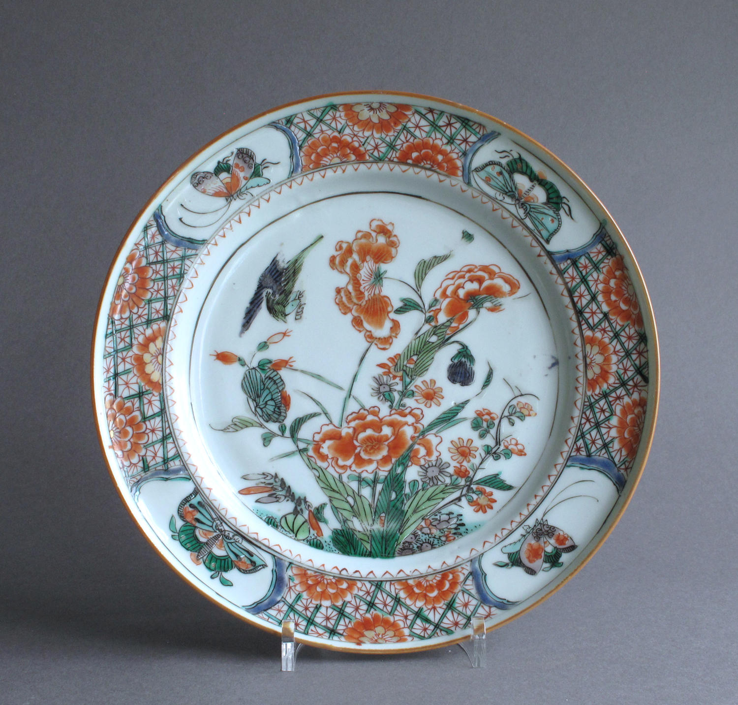 A Chinese famille verte plate with birds and peony, Kangxi