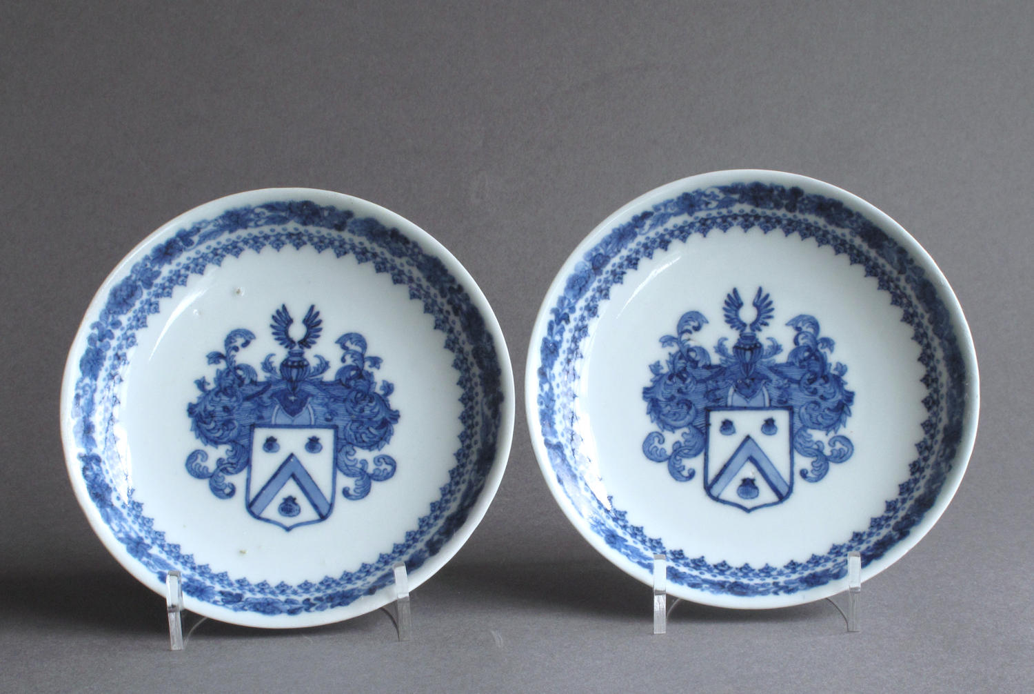 A rare pair of Chinese export Dutch armorial saucers c1735