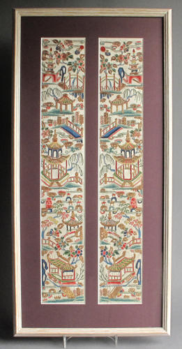 A framed finely worked pair of Chinese silk sleeve bands, C19th