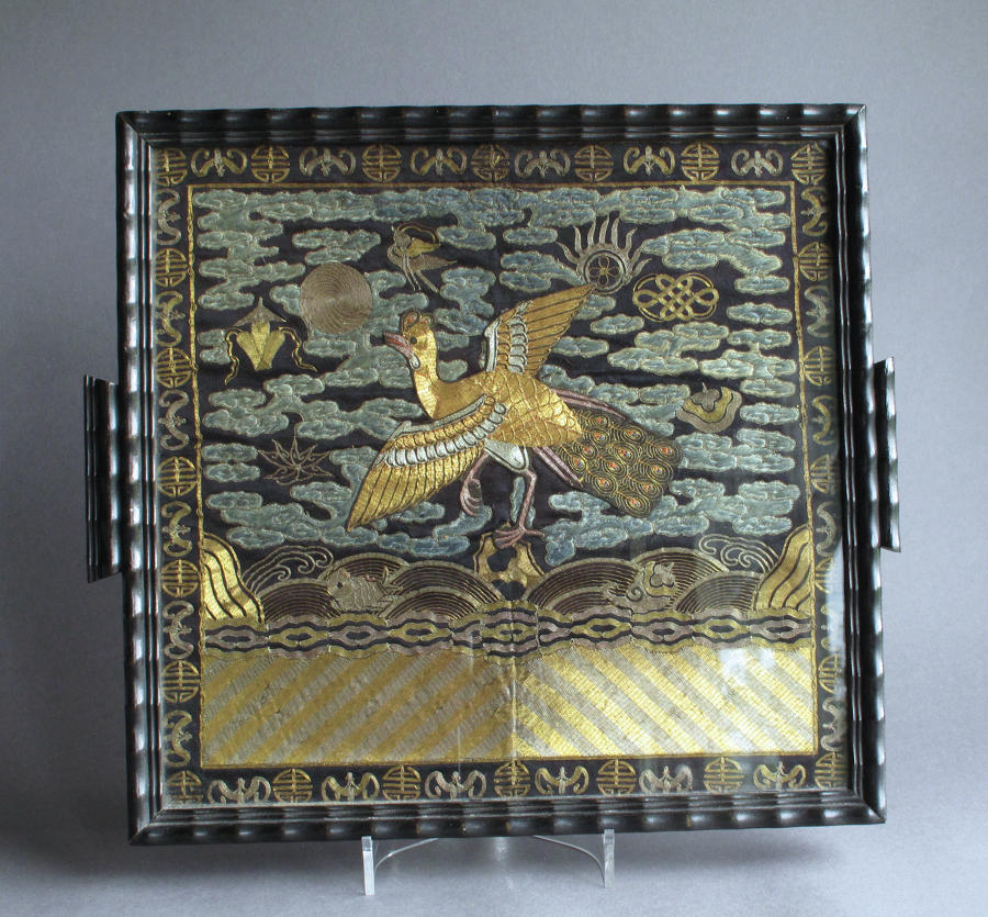 A Chinese late C19th silk rank badge, glazed and mounted as a tray