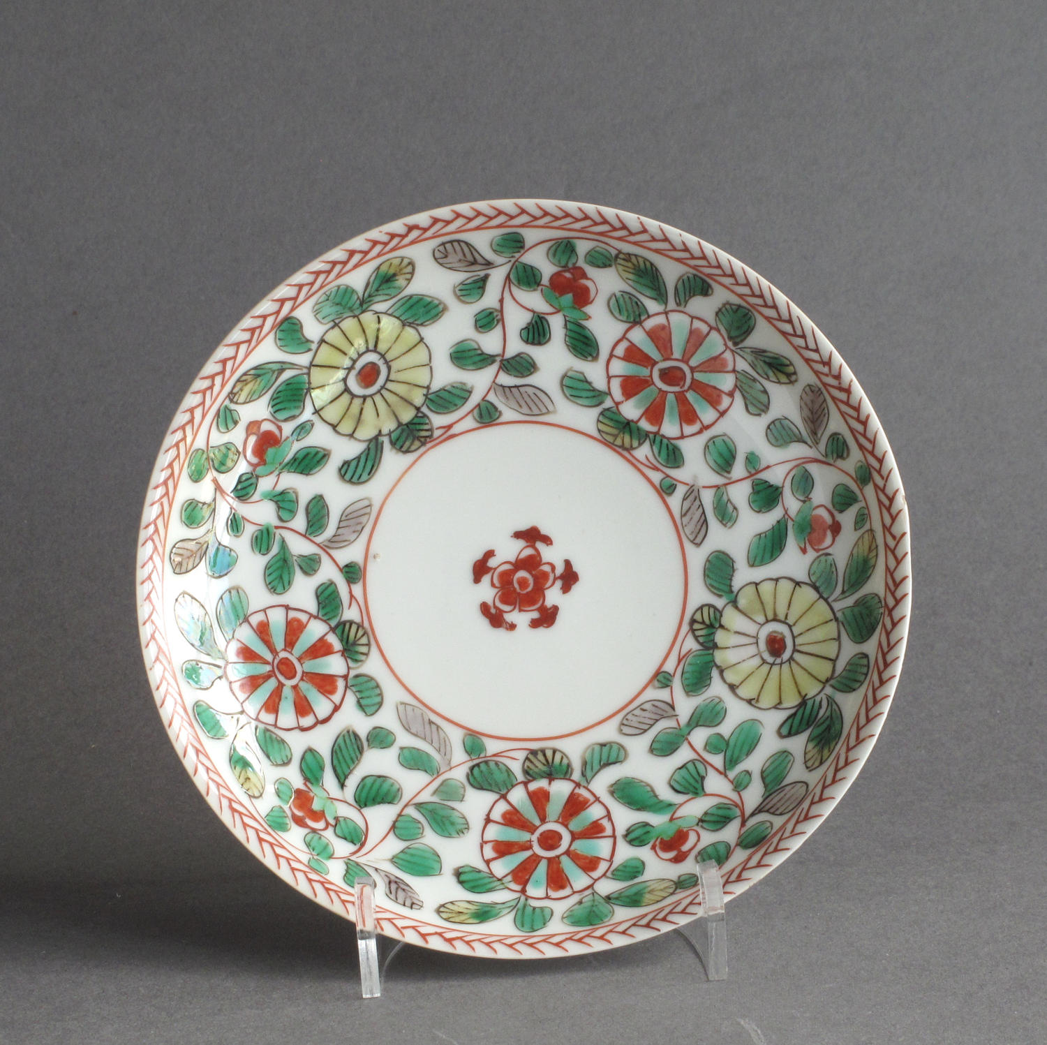A Chinese famille verte saucer, Kangxi