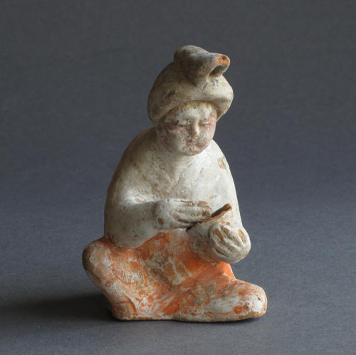 A charming small Tang Dynasty figure of a seated woman