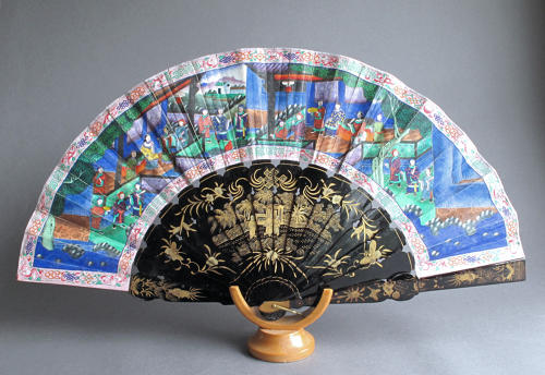 A Chinese export fan with black lacquered wooden sticks, late C19th