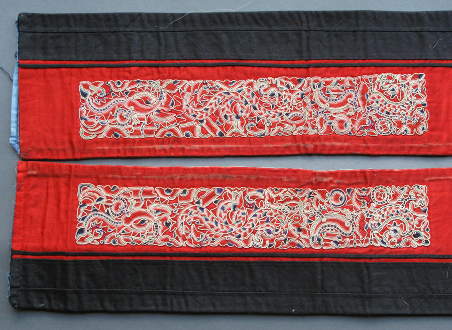 A pair of finely-embroidered Chinese sleeve bands cut from a robe, lat