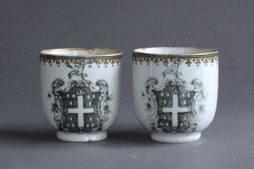 A pair of Chinese armorial grisaille coffee cups, Qianlong