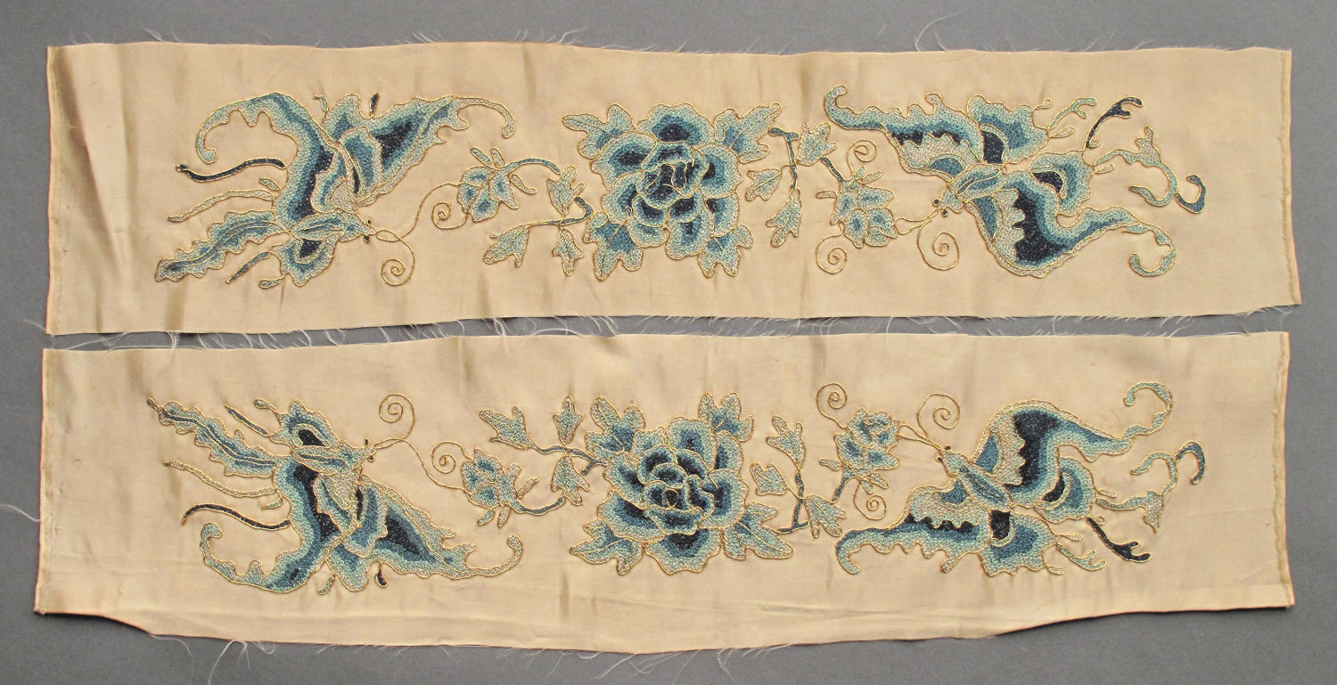 A pair of C19th Chinese silk sleeve bands in cream and blue