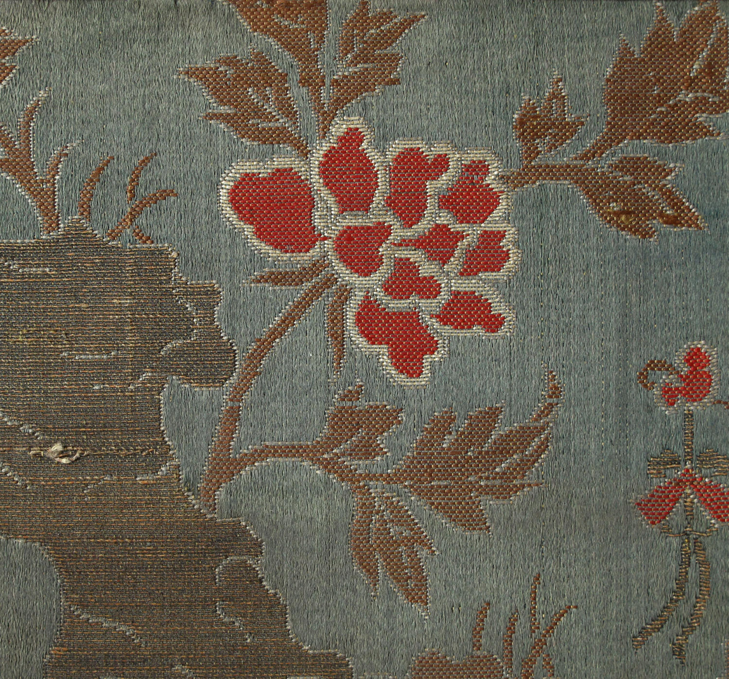 A mounted Chinese C18th silk square with paeony and rock work