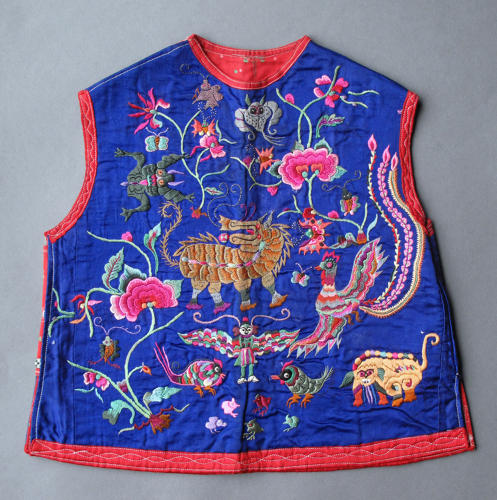 A charming Chinese silk sleeveless jacket for a child, early C20th