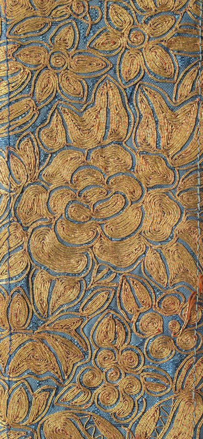 A good C19th Chinese sleeve band panel with gold couched embroidery