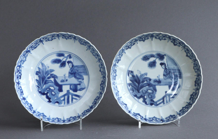 A pair of moulded Chinese saucer dishes, Kangxi