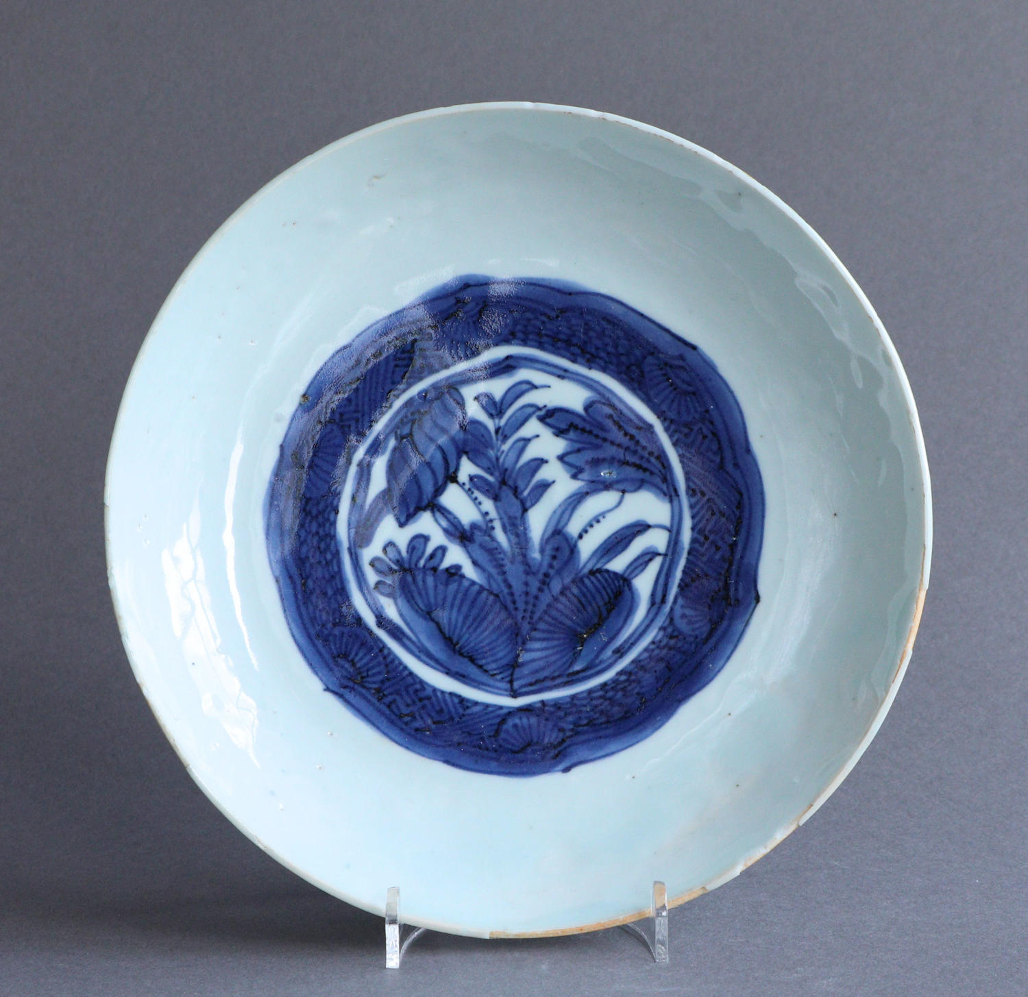A Chinese late Ming saucer dish with lotus design, Wanli