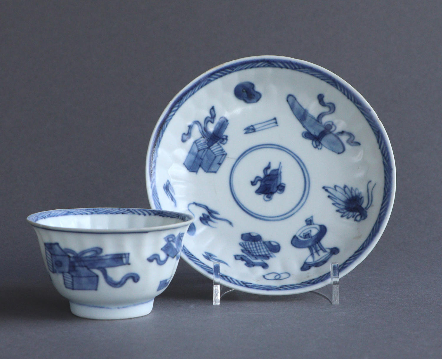 A Chinese 'Blue Chrysanthemum' wreck moulded tea bowl & saucer Kangxi