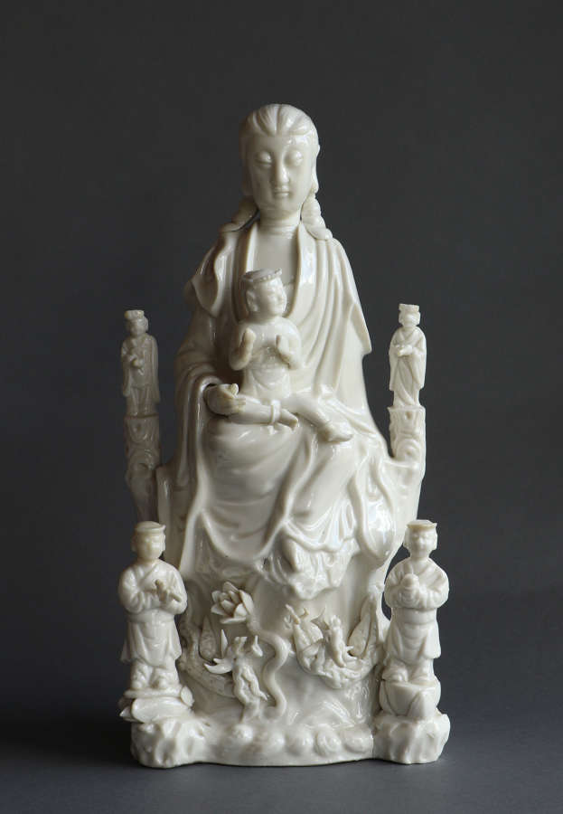 A large and well-detailed C18th Dehua blanc de Chine figure of Guanyin