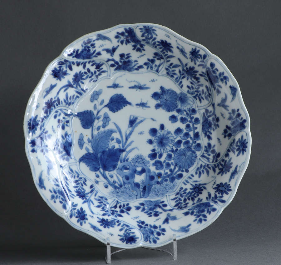 A Chinese underglaze blue plate with flowers and insects, Kangxi