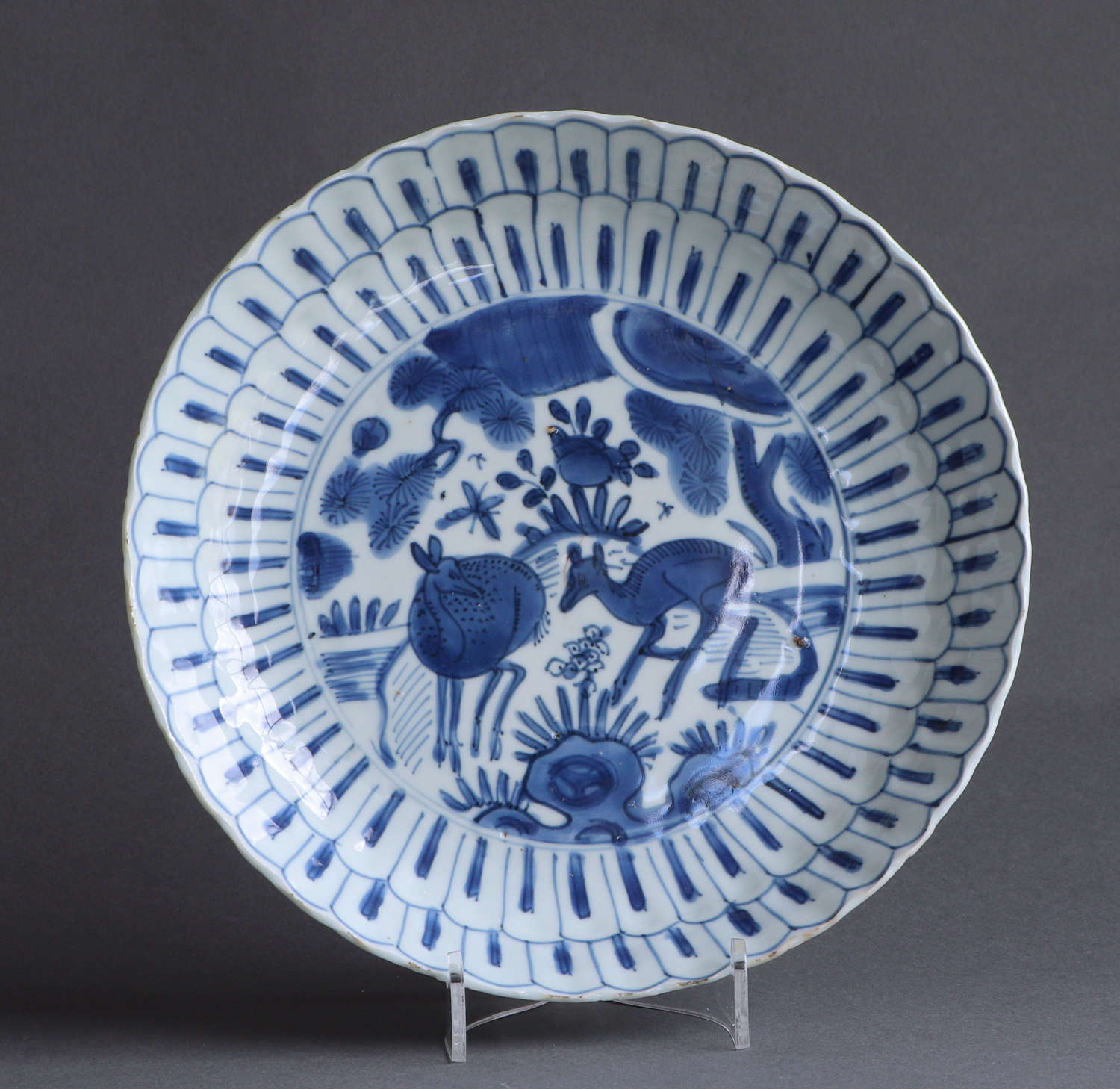 A Chinese late Ming dish with deer and pine trees