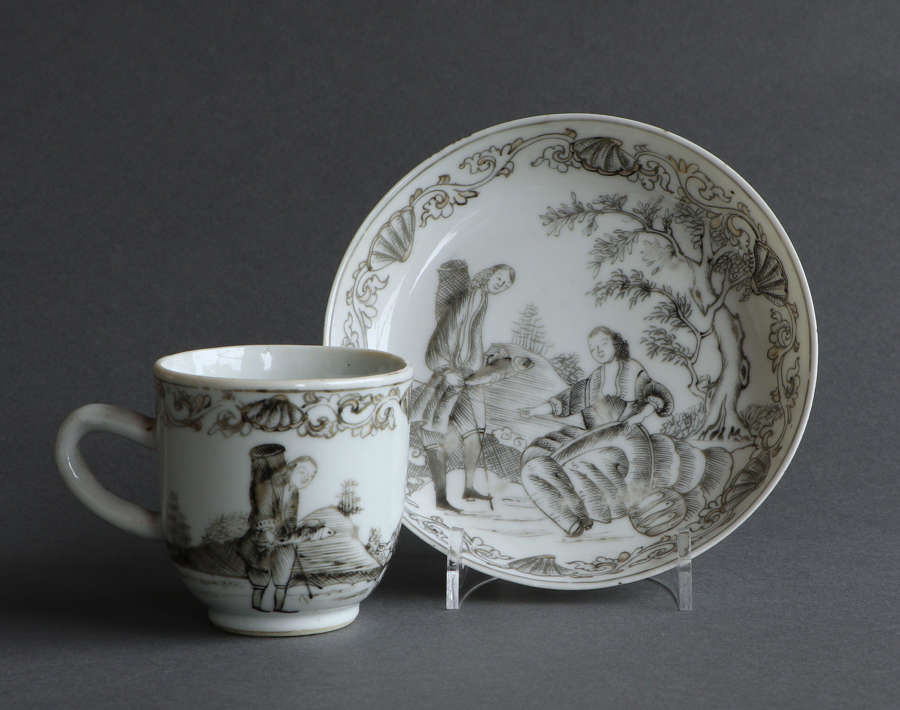 A Chinese export grisaille 'fishing' coffee cup & saucer, Qianlong