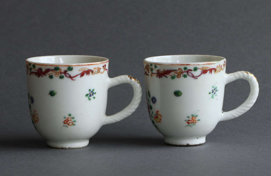 A pair of Chinese famille rose coffee cups with masonic design c1760