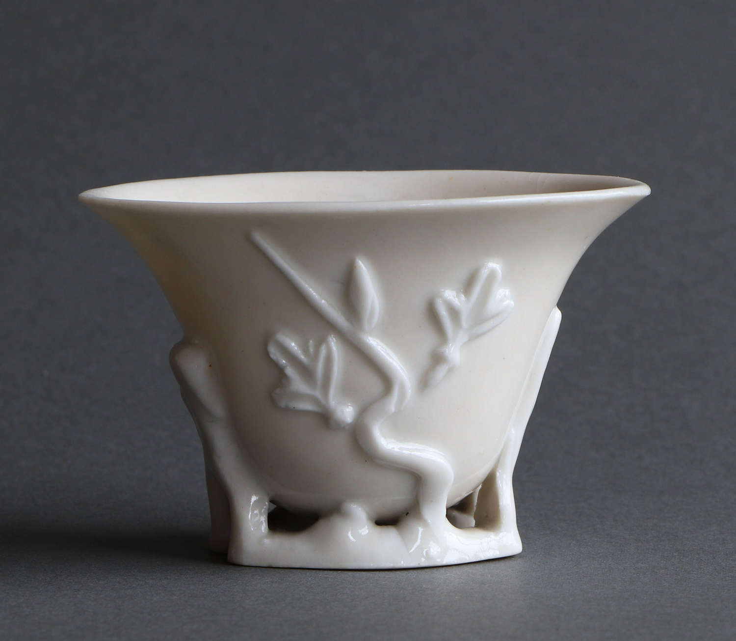 A Chinese blanc de Chine libation cup of rhinoceros horn form, Kangxi