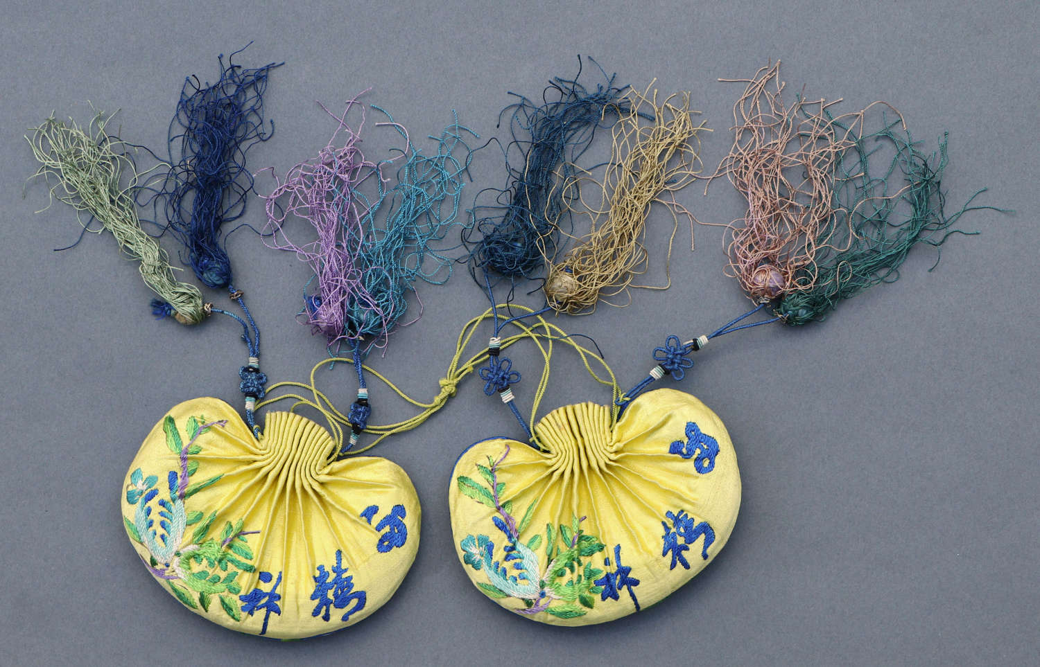A pair of Chinese silk embroidered purses, circa 1920