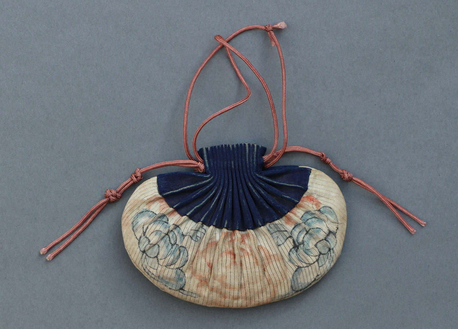 A late C19th/early C20th Chinese purse in cream and dark blue