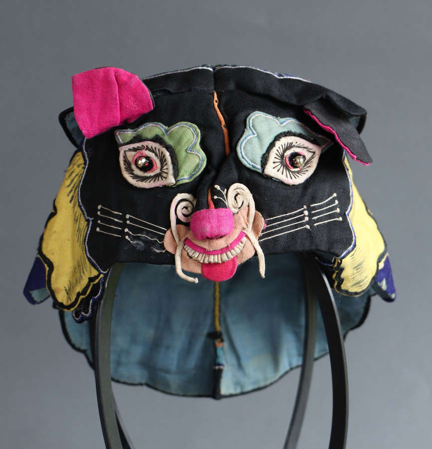 An early C20th Chinese boy's tiger hat, probably in cotton