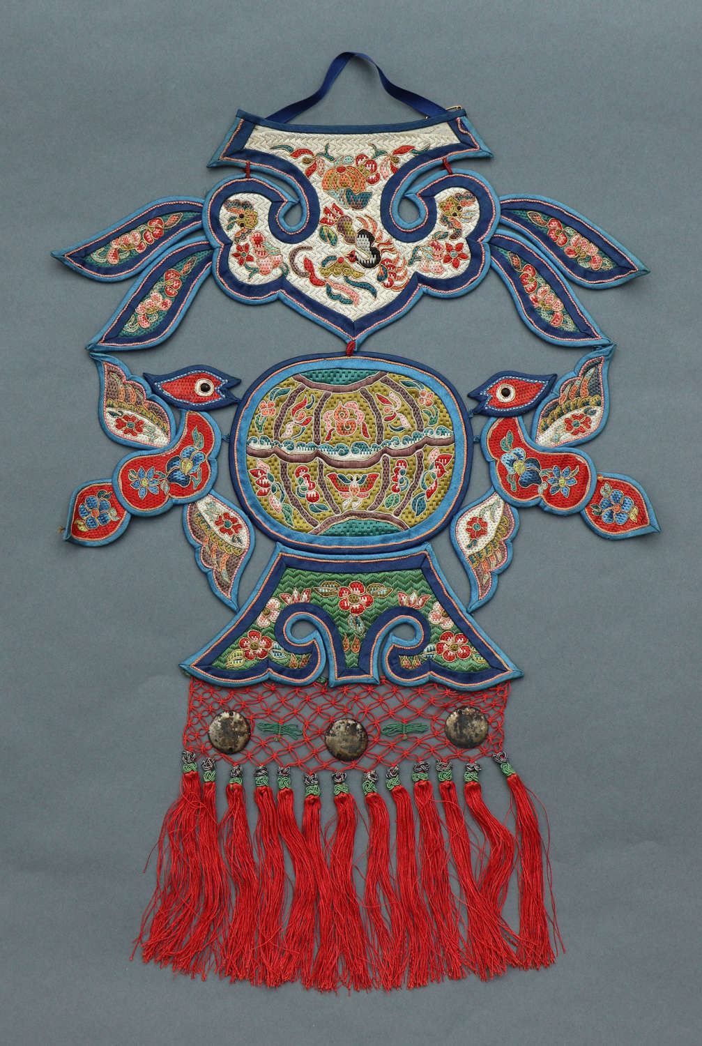 An early C20th Chinese silk neck pendant