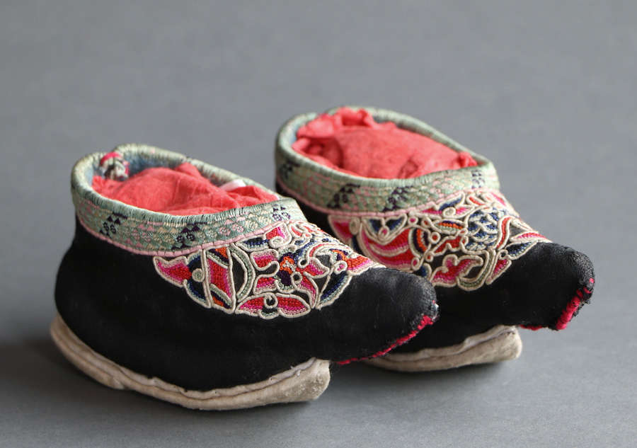 A late C19th pair of embroidered Chinese silk child's shoes in black