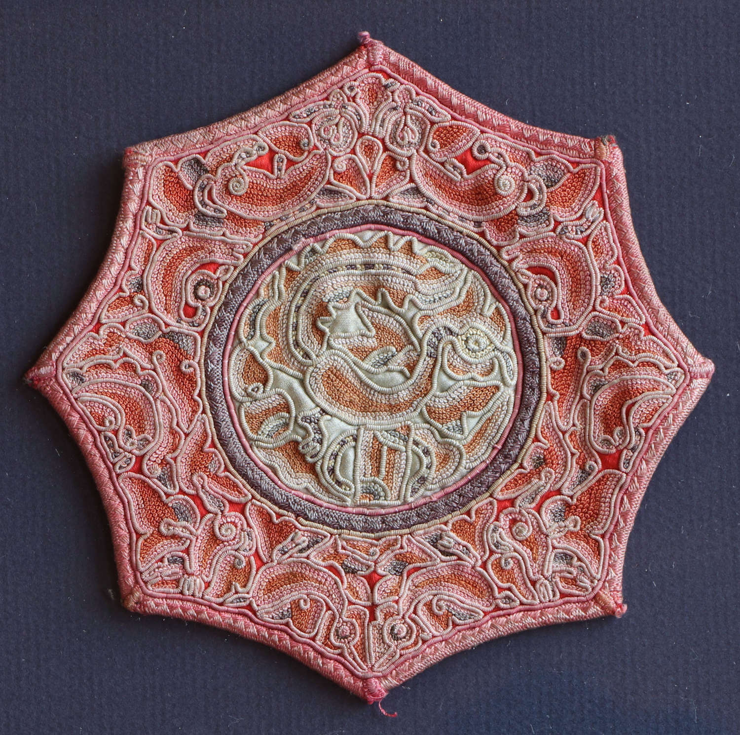 A small framed octagonal Chinese silk embroidery of a phoenix, C19th
