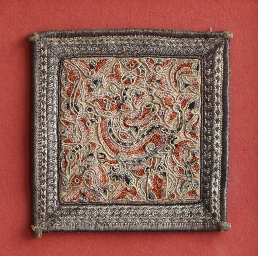 A small framed square Chinese embroidery of a dragon, C19th