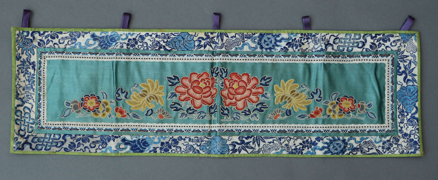 A small C19th Chinese horizontal silk panel of red and pink paeonies