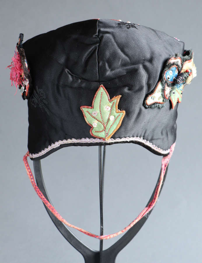 A late 19th century Chinese lady's black silk hat