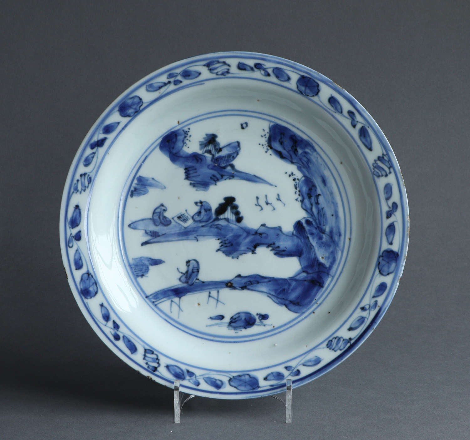 A Chinese late Ming dish with a landscape scene with scholars