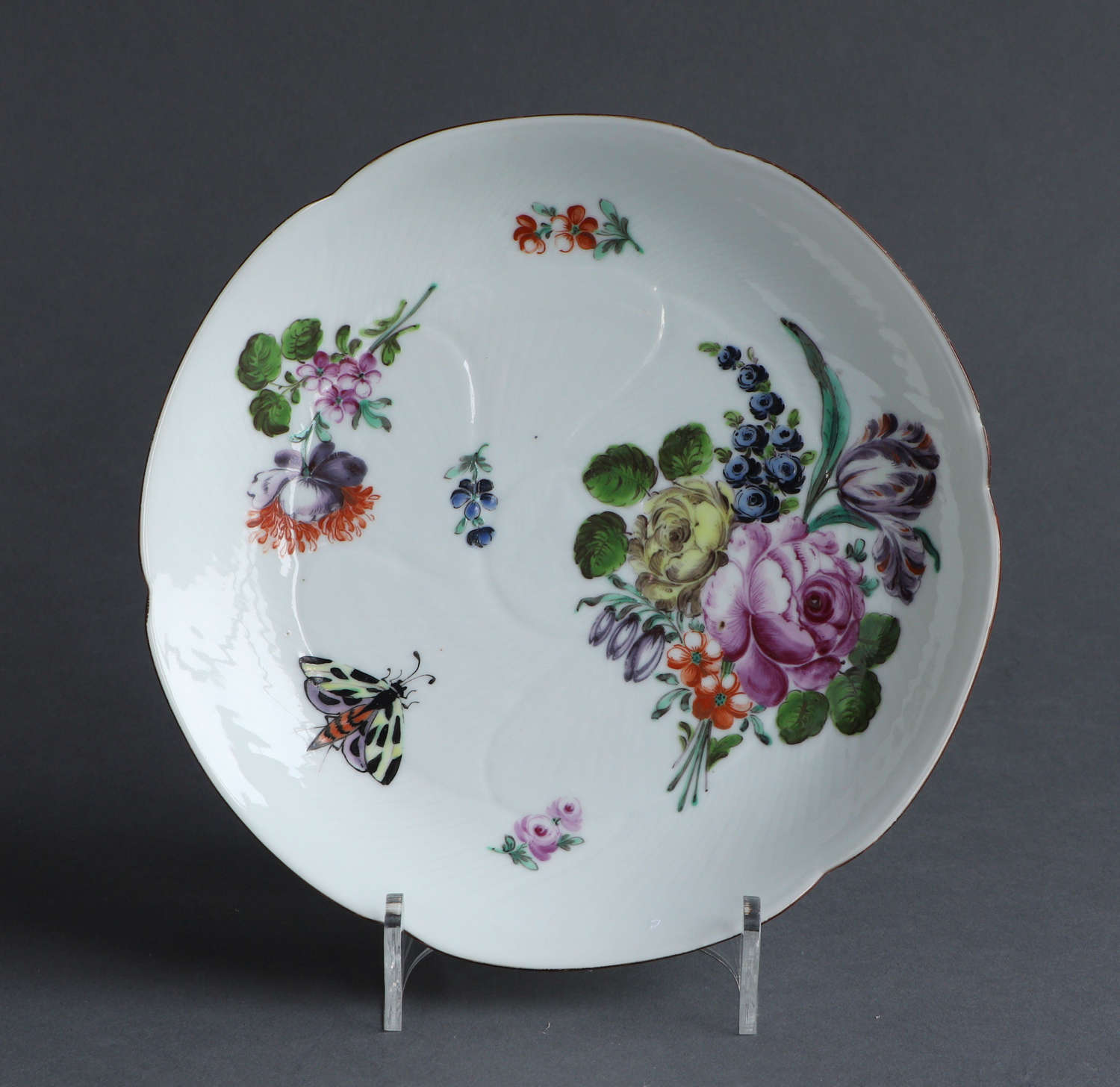 A good London decorated lobed Chinese export saucer dish, Qianlong