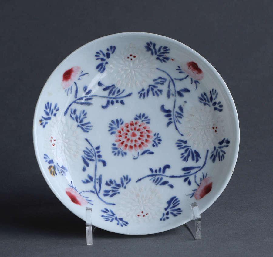 An unusual Chinese export famille rose saucer, Yongzheng or Qianlong