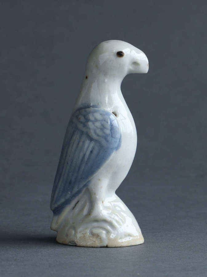 A small Chinese export underglaze blue model of a parrot