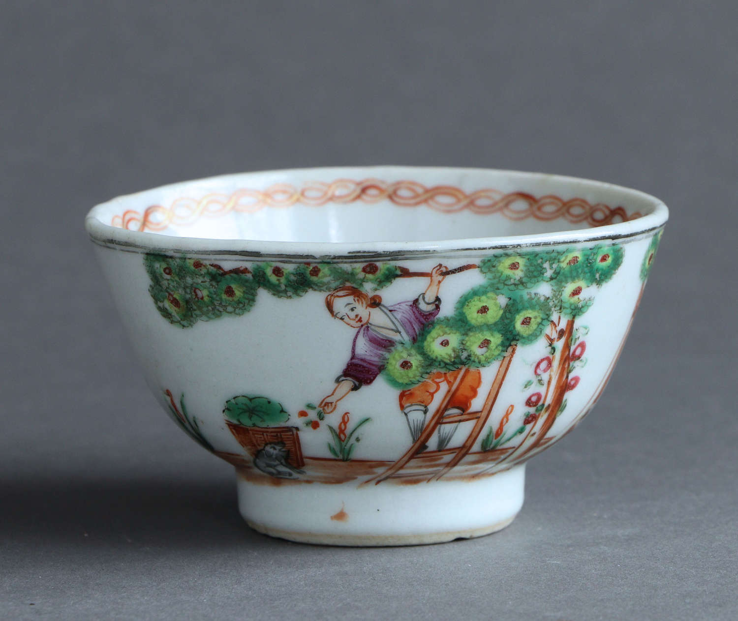A Chinese export famille rose 'Cherry Picker' teabowl, Qianlong